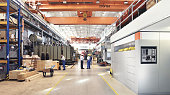 istock industrial factory in mechanical engineering for the manufacture of transformers - interior of a production hall 943839366