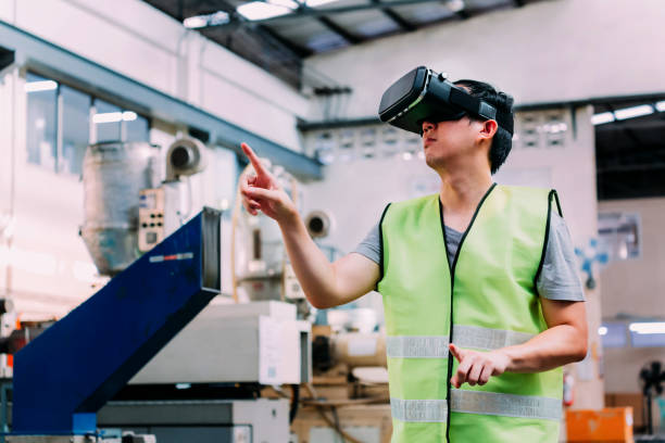 industrial factory worker wearing vr goggle touching in virtual reality world inside factory - realtà aumentata foto e immagini stock