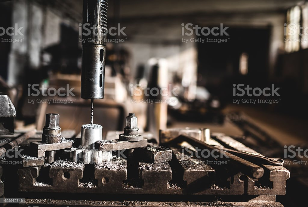 Industrial factory working details with automated lathe drilling stock photo