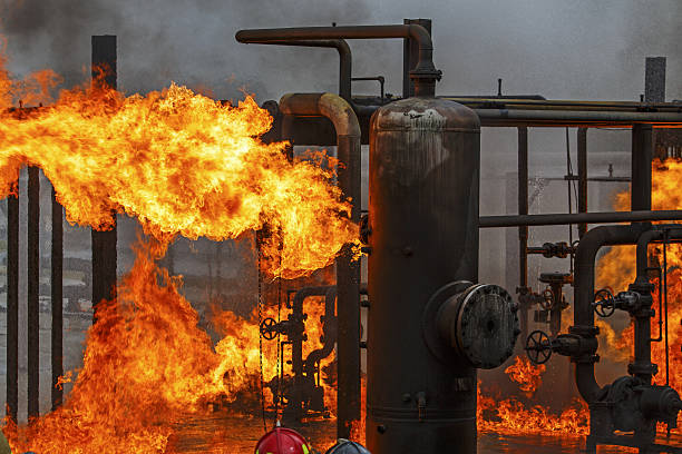 Industrial fire training for refinery or chemical plant fire brigade Industrial fire training for refinery or chemical plant fire brigade or fireman chemical plant stock pictures, royalty-free photos & images