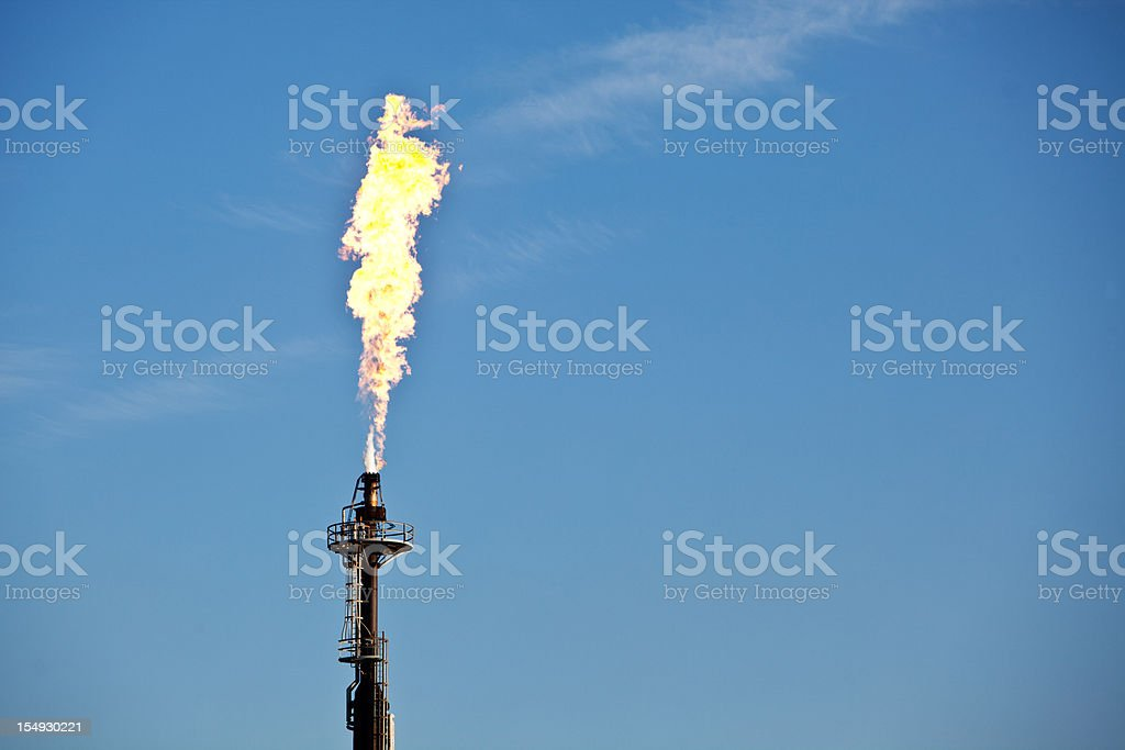Industrial flame burning off waste gas royalty-free stock photo
