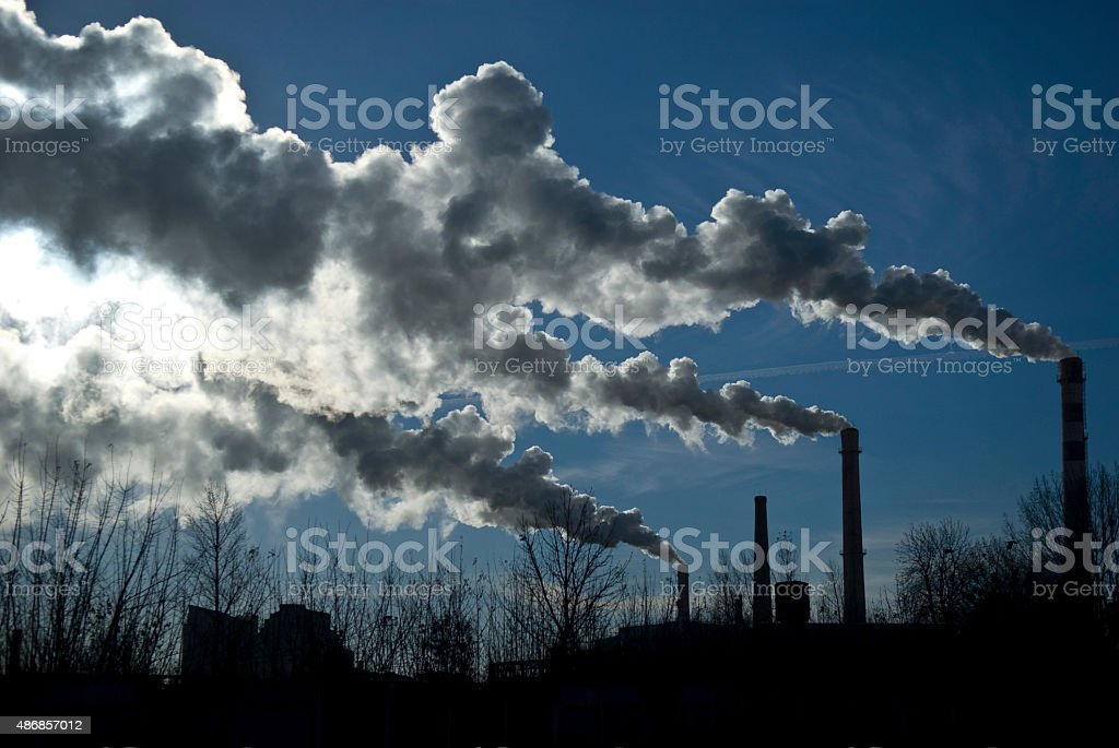 Industrial fuming pipes stock photo