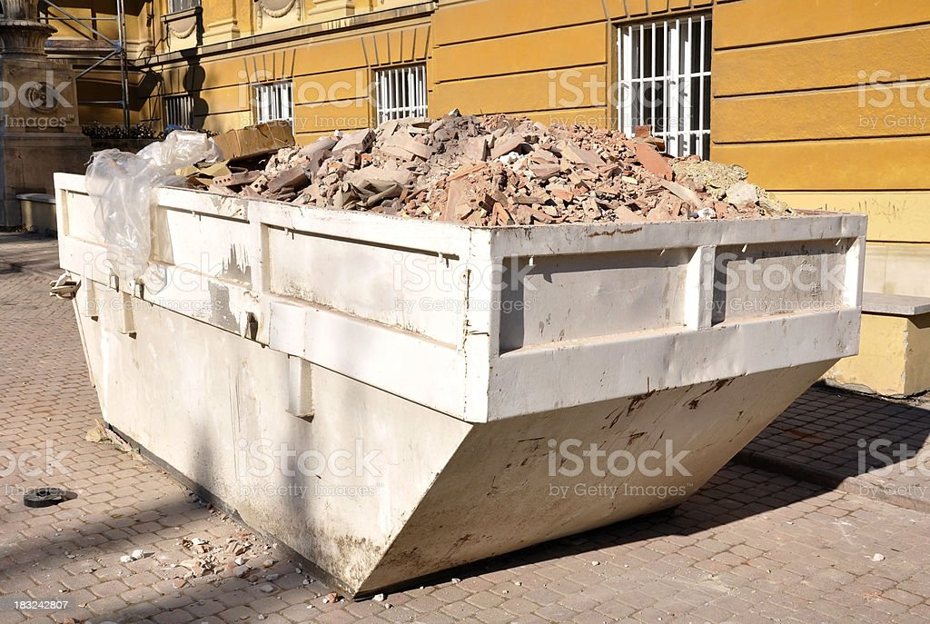 industrial garbage bin at a construction site royalty-free stock photo