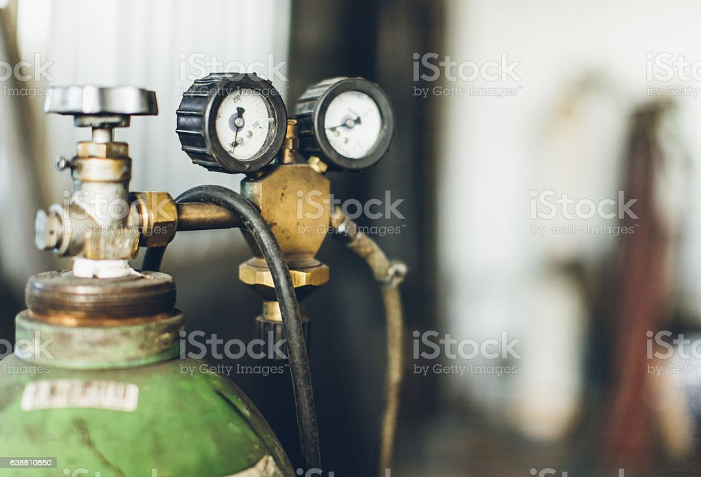 Industrial gas cylinder with pressure gauges stock photo