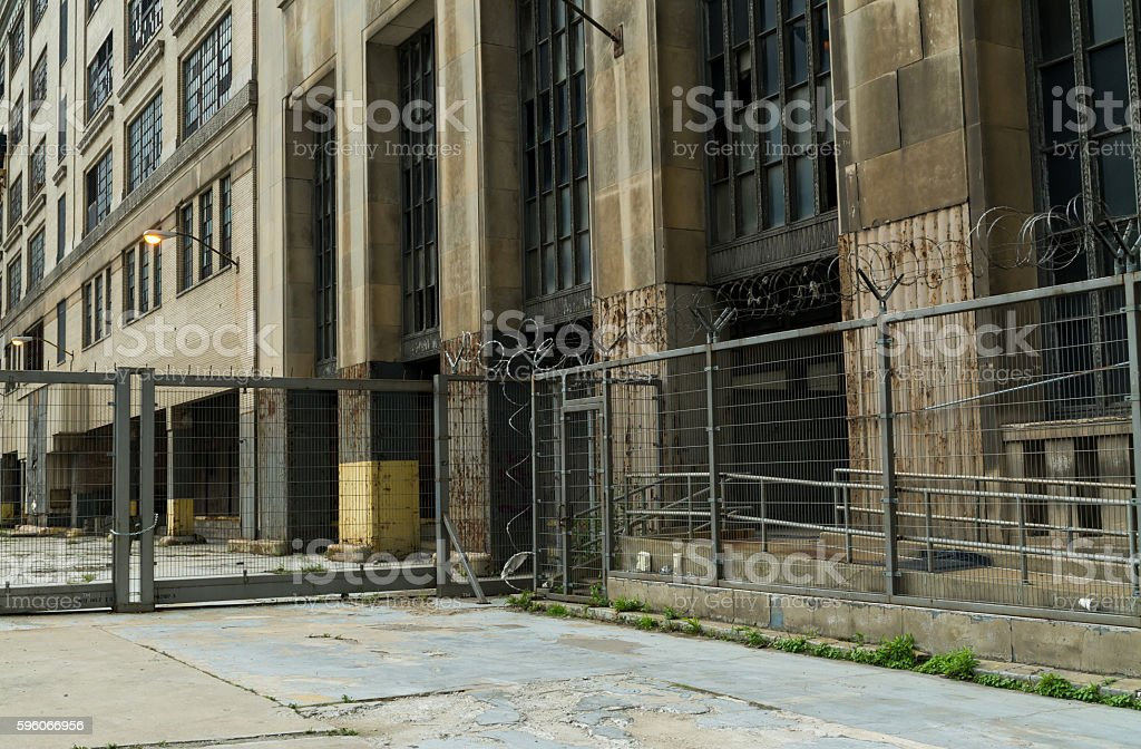 Industrial gate and abandoned building. royalty-free stock photo