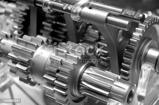 Partial view of gears in a machine in black and white
