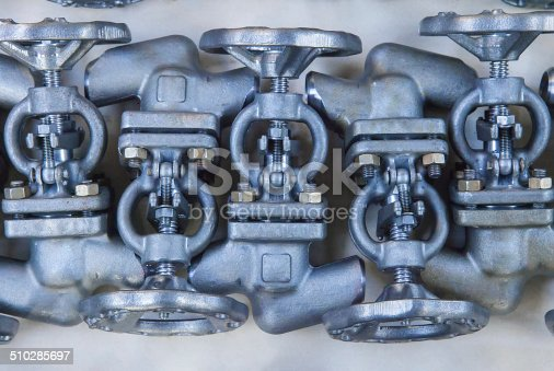 Background from industrial globe valves ready for dispatch on Euro pallet