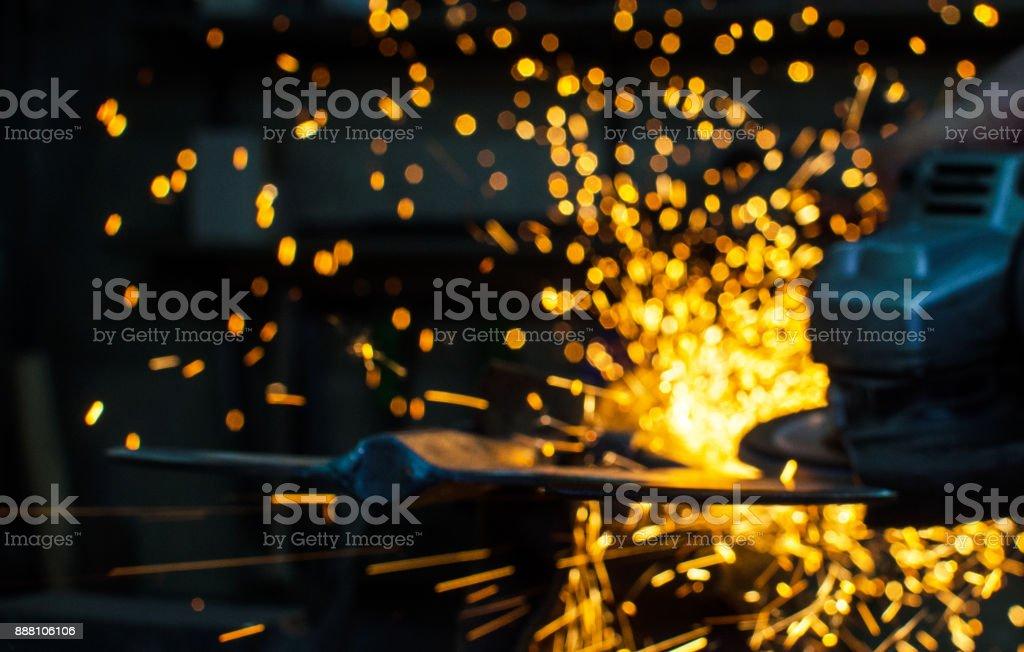 Industrial grinder blurred showers sparks stock photo