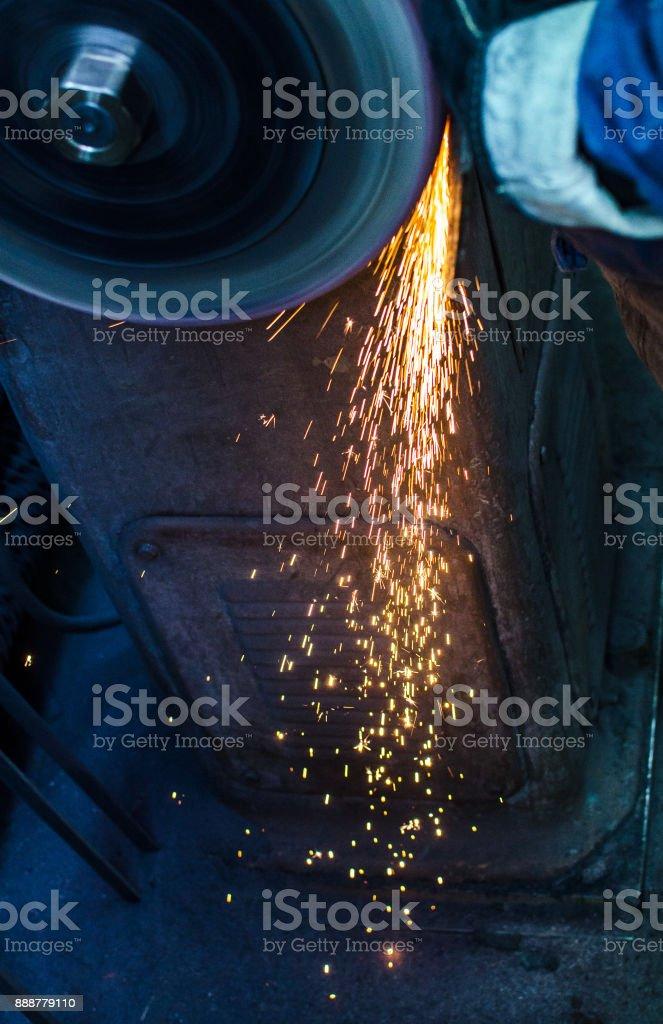 Industrial grinder showers sparks stock photo