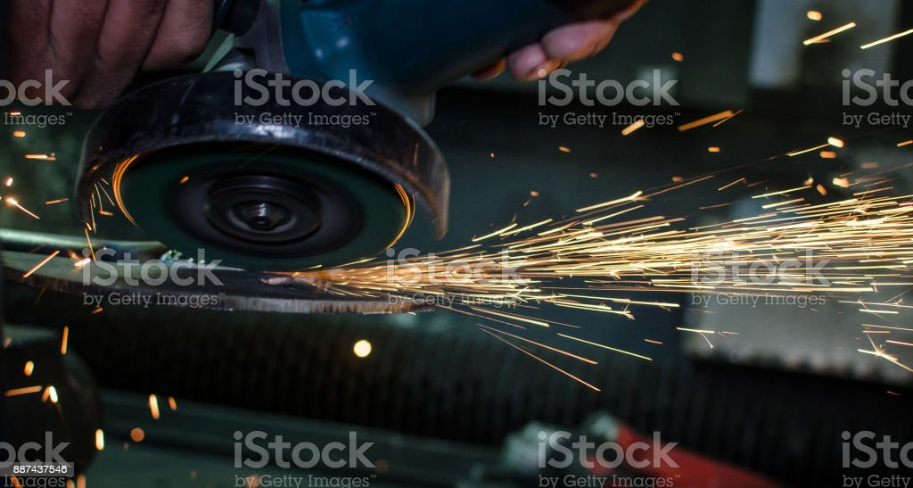 Industrial grinder with sparks stock photo