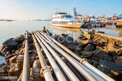 Industrial harbor cruise ships and pumping discharge pipes
