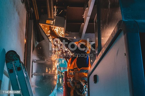 istock industrial hvac repair installation worker process 1140800488