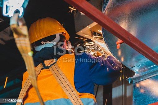 istock industrial hvac repair installation worker process 1140800496