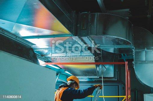 istock industrial hvac repair installation worker process 1140800514