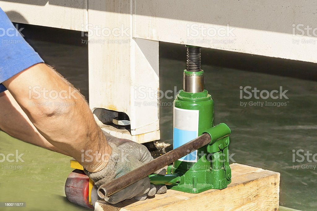 industrial hydraulic floor jack heavy lifting stock photo