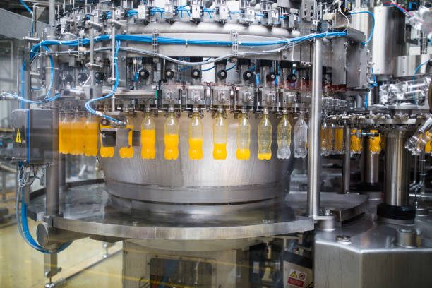 industrial indoors and machinery - bottling plant stock photos and pictures