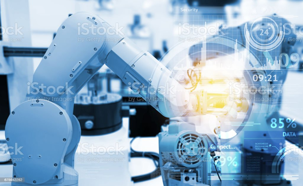 Industrial internet of things and industry 4.0 concept. Abstract blue background of technology graphic and automation wireless control robotic machine in smart factory with flare light effect. stock photo