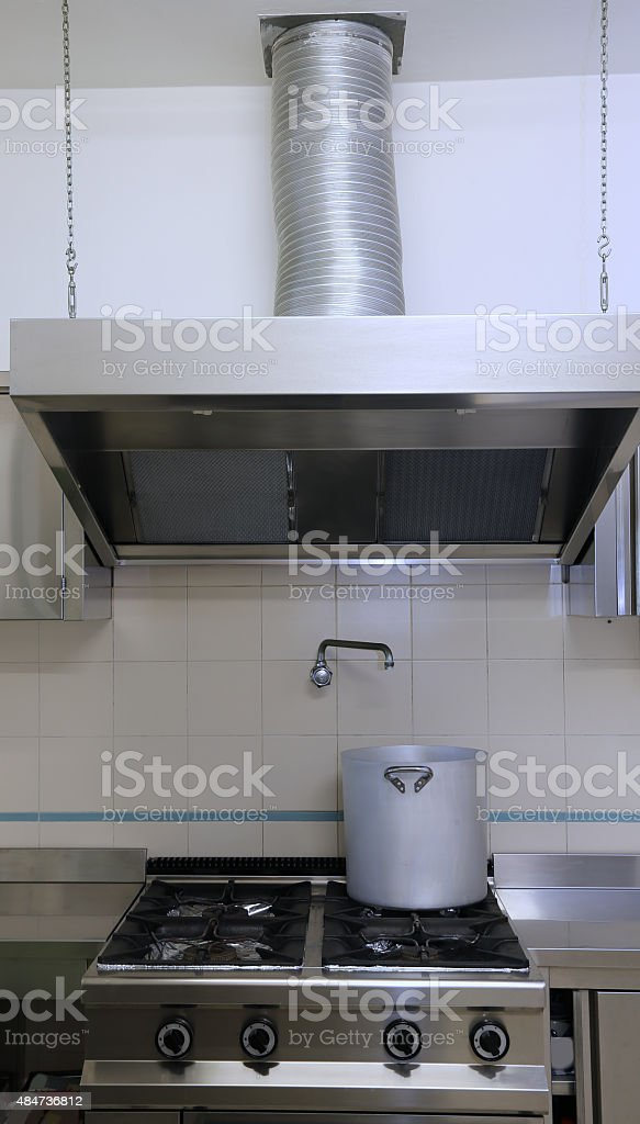 industrial kitchen cooker with aluminum pot and the giant smoke stock photo