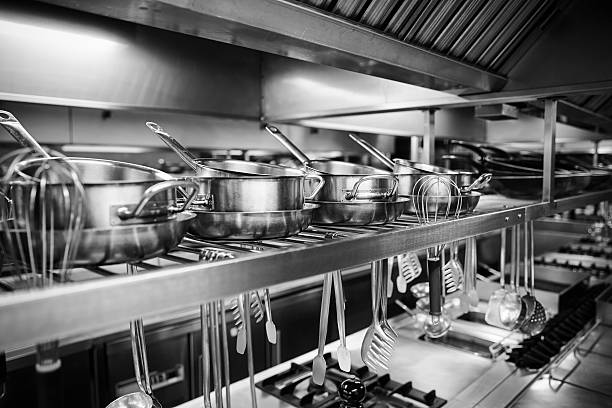Industrial Kitchen - Pots and tools on shelves Industrial Kitchen - Pots and tools on shelves cooking black and white stock pictures, royalty-free photos & images
