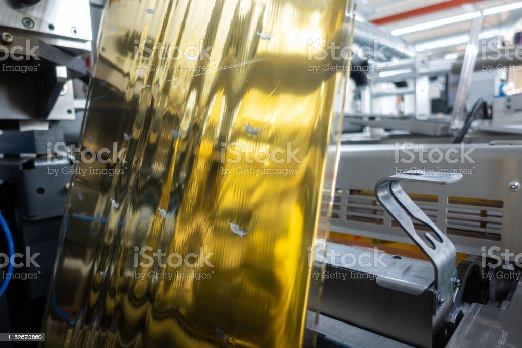 Industrial Label Printing Equipment Closeup DetailMetallic Foil...