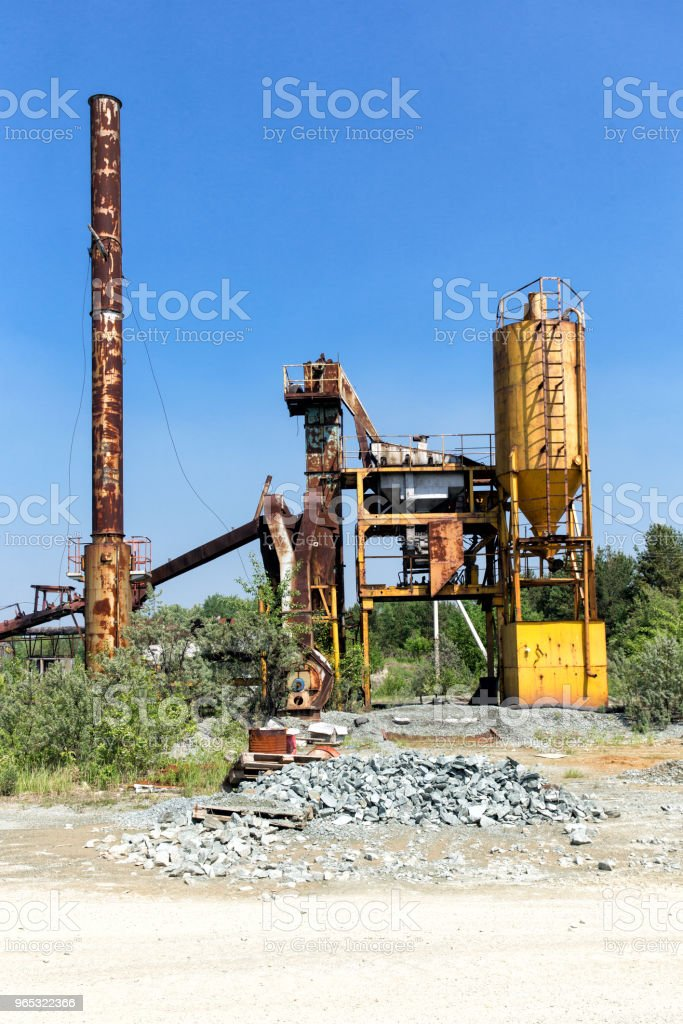 Industrial landscape. Old abandoned plant for the production of asphalt royalty-free stock photo
