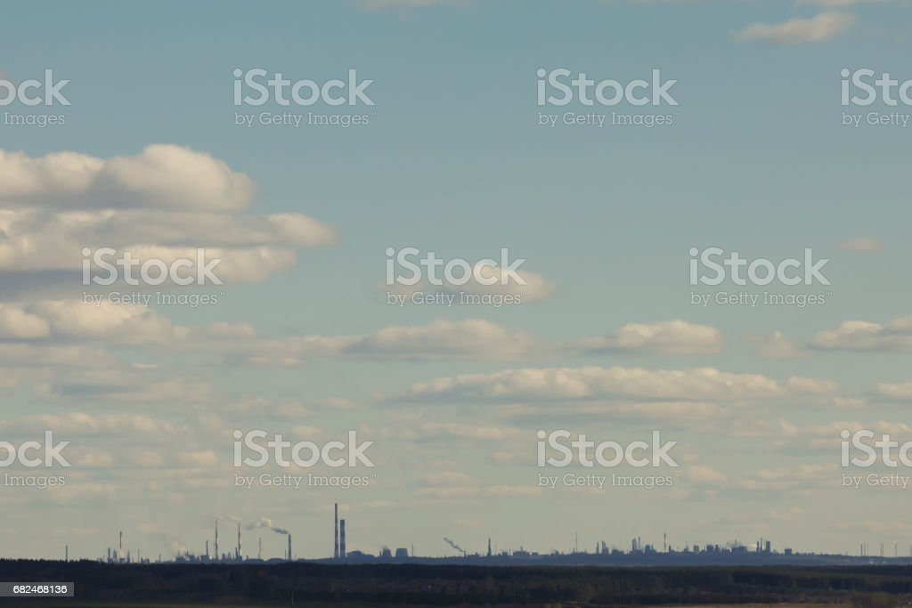 Industrial landscape - silhouette in front of clouds royalty-free stock photo