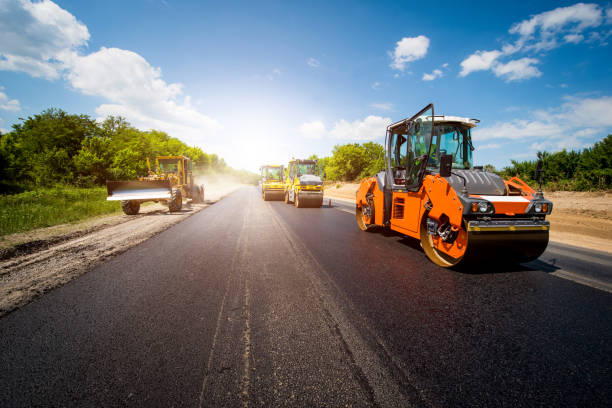 industrial landscape with rollers that rolls a new asphalt in the roadway. Repair, complicated transport movement. industrial landscape with rollers that rolls a new asphalt in the roadway. Repair, complicated transport movement. asphalt stock pictures, royalty-free photos & images