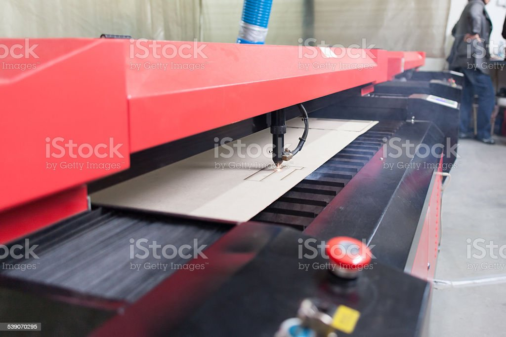 industrial laser cutter stock photo