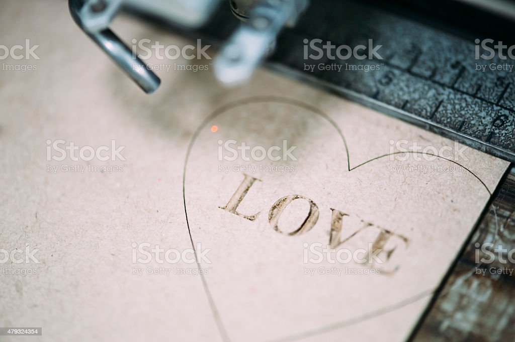 Industrial laser engraving on a paperboard stock photo