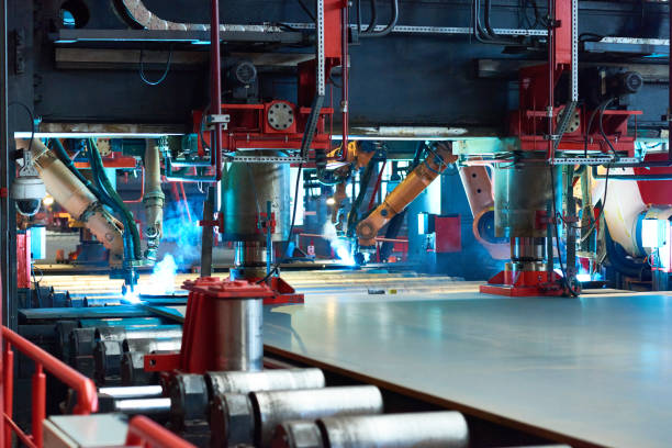 industrial lasers cutting metal sheet on rolling mill - metallurgy stock photos and pictures