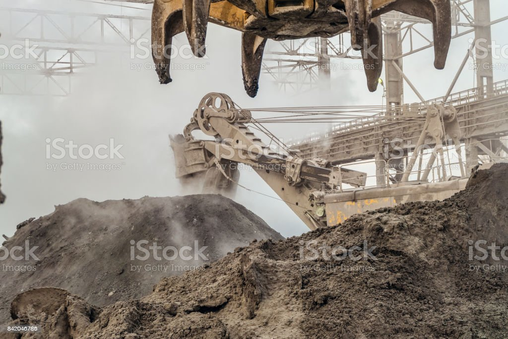 Industrial loading equipment. Hot slag in the outdoors shop of metallurgy. Heavy industrial metallurgical foggy landscape. stock photo