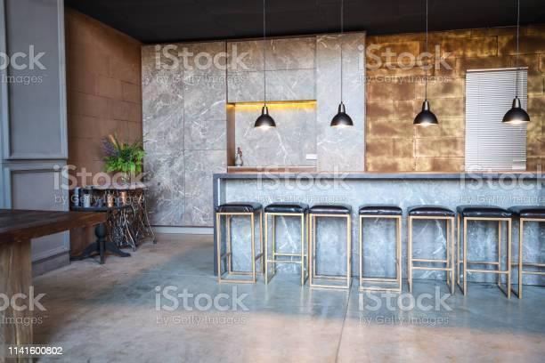 Industrial loft bar style the room has a lot of chairs at the bar picture id1141600802?b=1&k=6&m=1141600802&s=612x612&h=urqq6irfqf6g4hlf10ahfciinj1anslm 33acbdrflg=