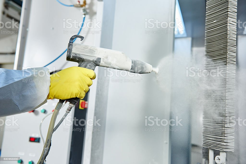industrial metal coating. Man in protective suit, wearing a gas stock photo