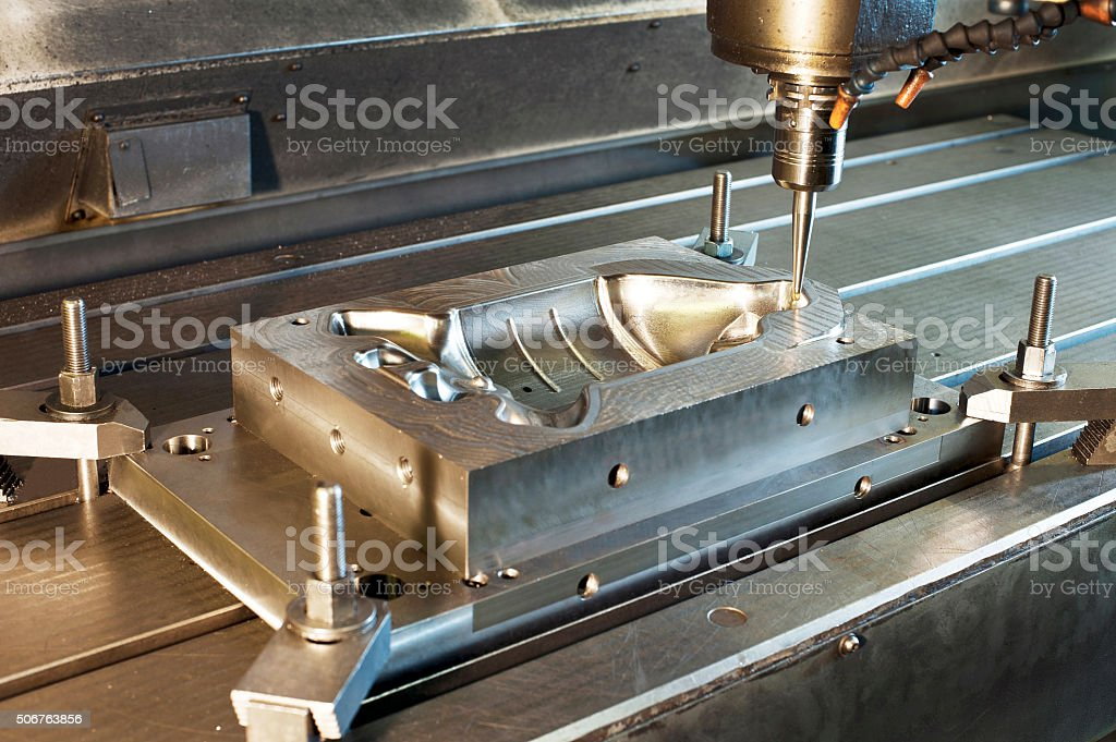 Industrial metal mold/blank milling. CNC technology and metal engineering. stock photo