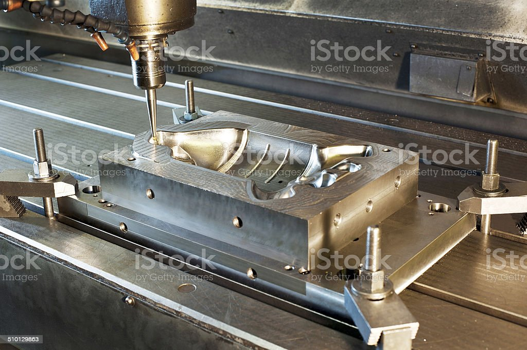 Industrial metal mold/blank milling. CNC technology. stock photo