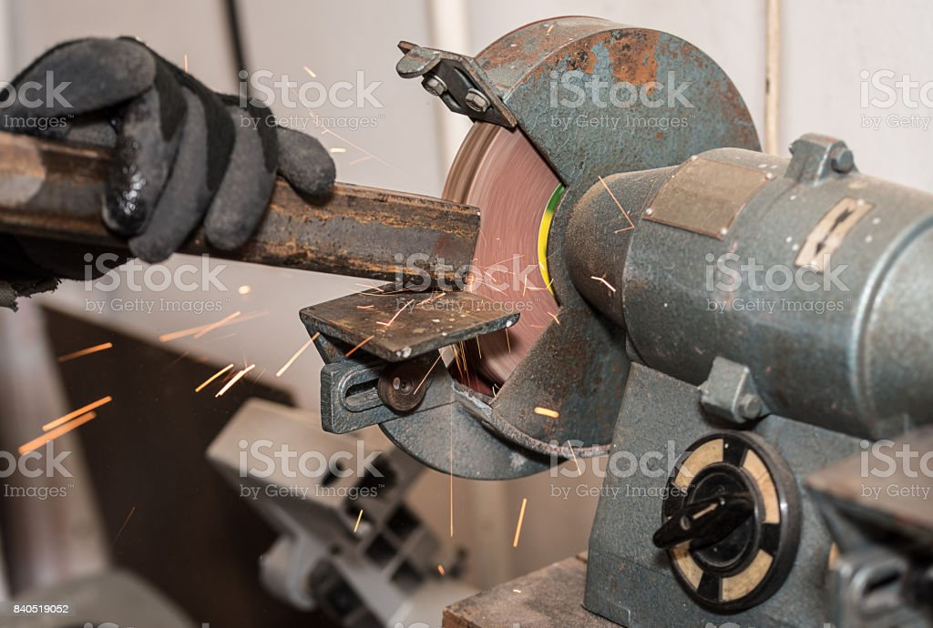 Industrial metal worker use the grinding machine stock photo