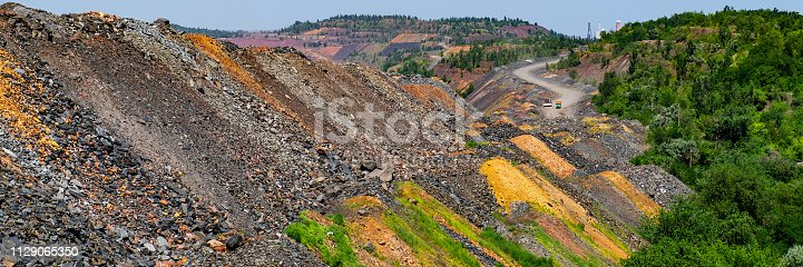 industrial mining waste dumps quartzite stones. Summer season. Web banner.
