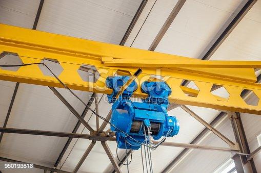 Hoist of Industrial overhead crane in factory. Close up