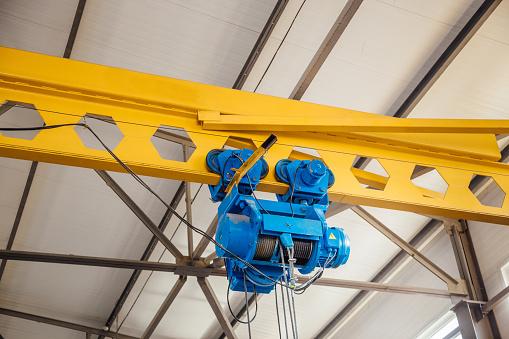 Industrial overhead crane in factory