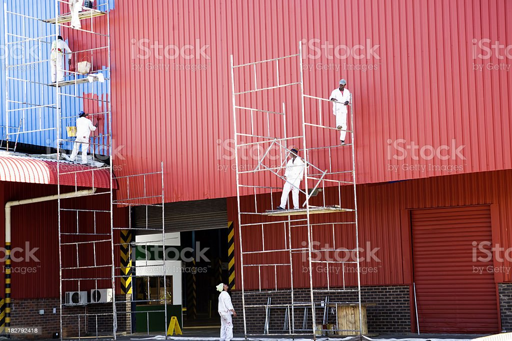 Industrial painters painting factory stock photo