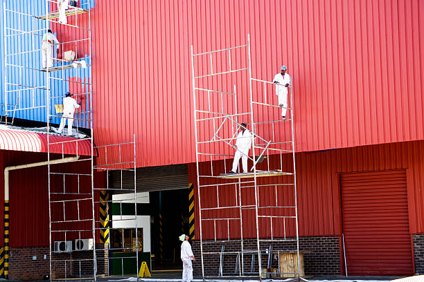 industrial painters painting factory - painter stock photos and pictures