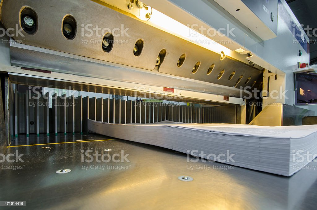 Industrial paper guillotine in a print shop stock photo