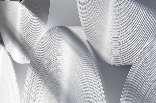 Rolls of white industrial paper.