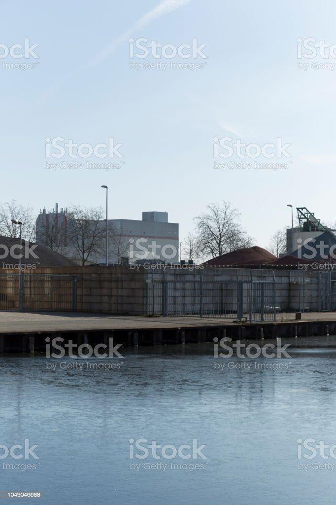 Industrial park standing still during winter chill.