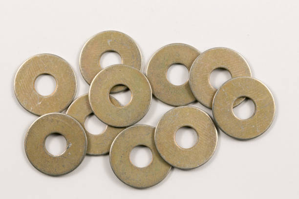 Industrial Part - Washers Small generic industrial part used in mechanical applications washer fastener stock pictures, royalty-free photos & images