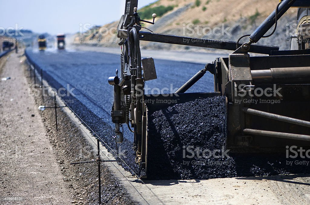 industrial pavement truck laying fresh asphalt stock photo