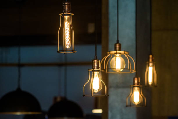 Industrial pendant lamps against rough wall. Loft interior. Edison bulbs Industrial pendant lamps against rough wall. Loft interior. Edison bulbs. amulet stock pictures, royalty-free photos & images
