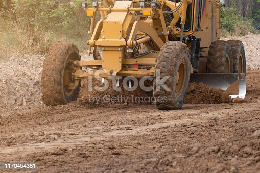 Motor grading work in road construction, road construction machinery