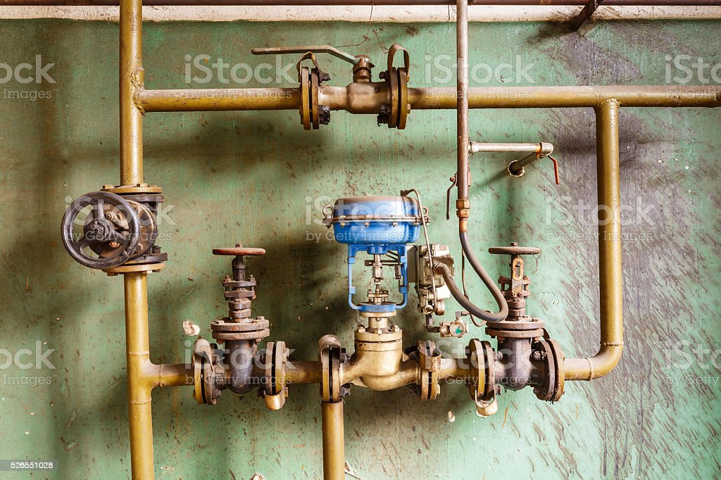 Industrial pipe valves Control system in the old steel mill stock photo