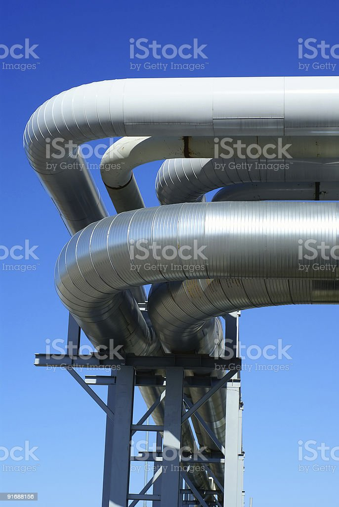 industrial pipelines against blue sky royalty-free stock photo